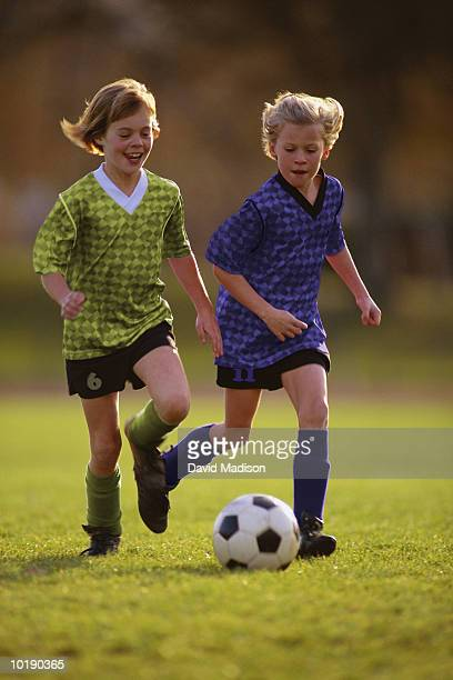 Girls (9-12) playing soccer