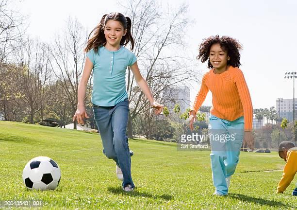 Girls (8-10) playing soccer