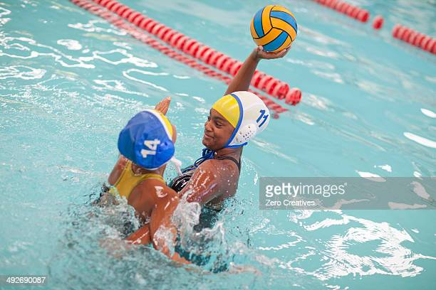 girls playing water polo - water polo stock pictures, royalty-free photos & images
