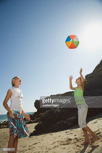 Girls playing with ball at the beach
