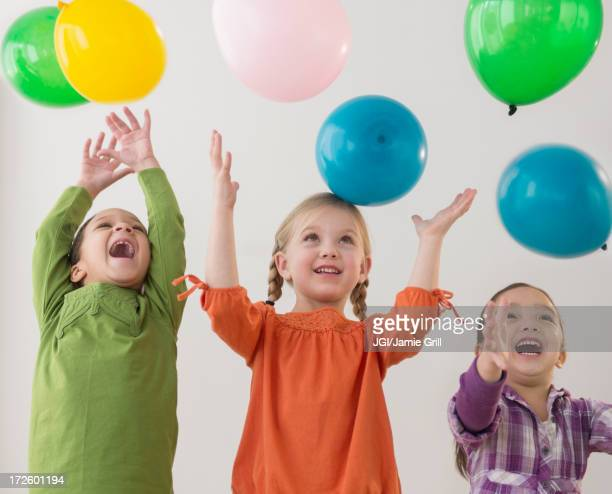 Girls playing with balloons