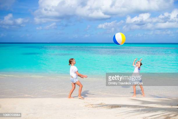 girls playing with beach ball - children only stock photos and pictures