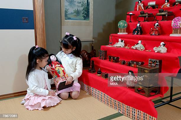 Girls playing with doll