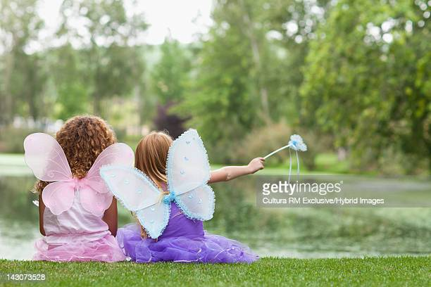 Girls playing with fairy wings and wand
