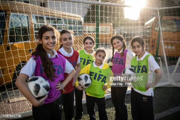 Girls pose for a group picture during a FIFA Grassroots schools program on January 25, 2019 in Amman, Jordan.