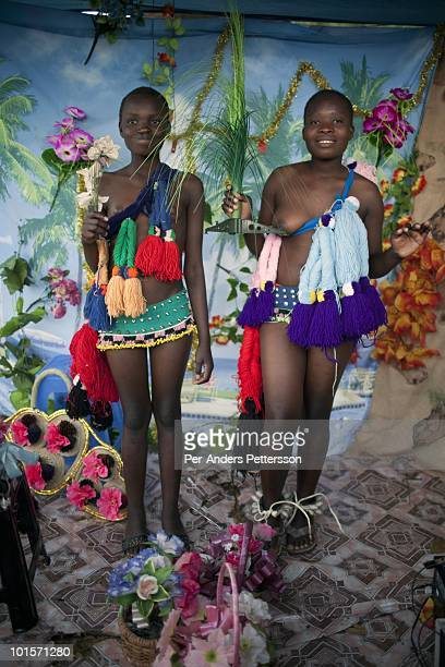 Girls pose for pictures in a photo studio before at a traditional Reed dance ceremony at the stadium at the Royal Palace on August 29 in Ludzidzini...