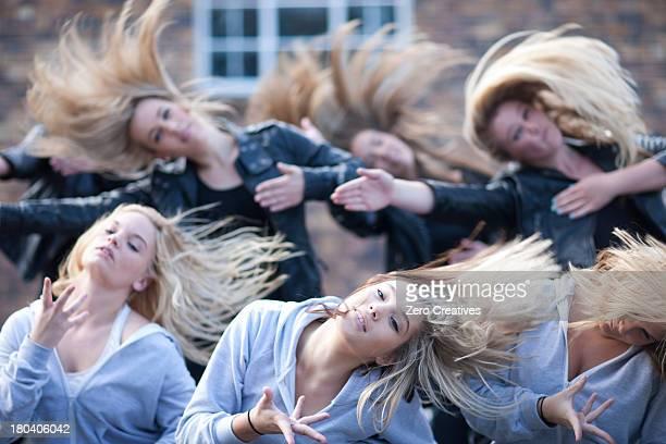 Girls practicing dance in carpark