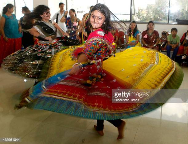 Girls practicing for the Garba and Dandiya Raas dances performed during the Navratri festival celebration at Malad on September 22 2014 in Mumbai...