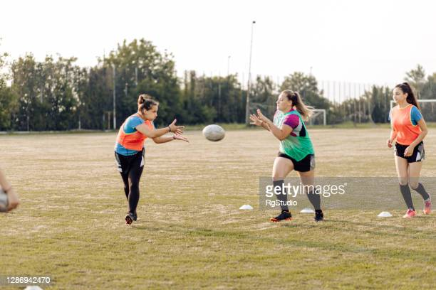 girls practicing passing in rugby - rugby stock pictures, royalty-free photos & images