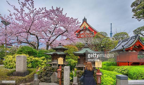 A girls prayer in front of Asakusa Sensoji Temple