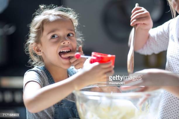 girls preparing dough - girls licking girls stock pictures, royalty-free photos & images