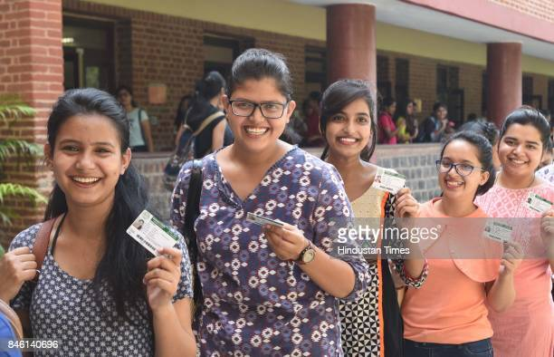 Girls queue up to cast their votes for the DUSU Election at Miranda College in North Campus on September 12 2017 in New Delhi India