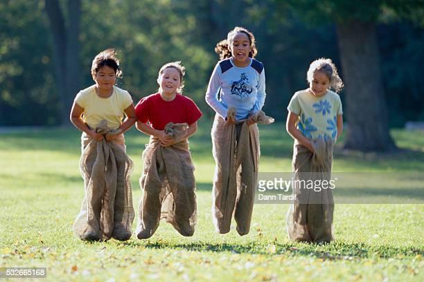 Girls Racing in Potato Sacks