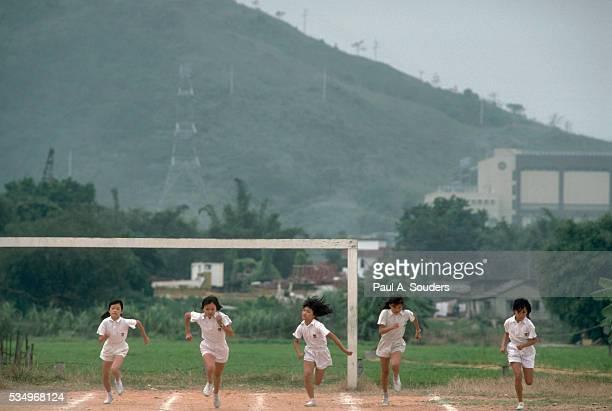 Girls Racing on Playground