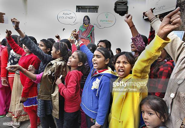 Girls raising slogans during a march organised by the Apne Aap Women Worldwide NGO in memory of 'Nirbhaya' the symbolic name given to the victim of...