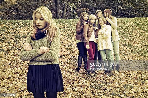 """girls rejecting one from the group. - """"martine doucet"""" or martinedoucet stock pictures, royalty-free photos & images"""
