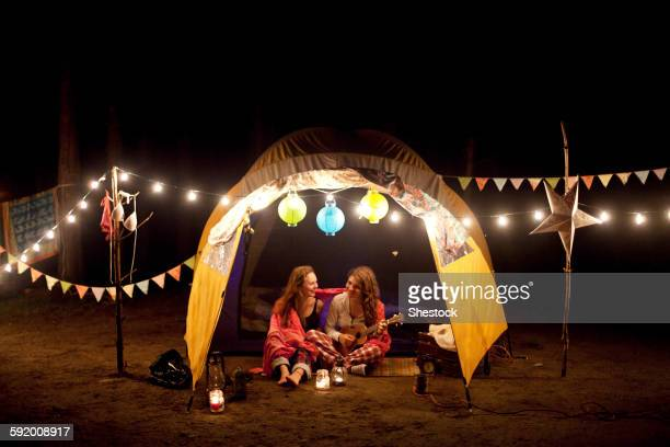 girls relaxing in camping tent at night - massachusetts stock pictures, royalty-free photos & images