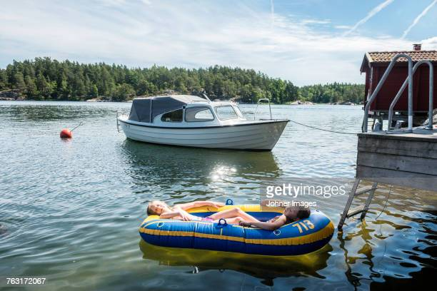 Girls relaxing in inflatable boat