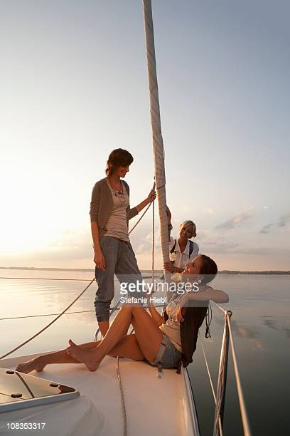Girls relaxing on boat