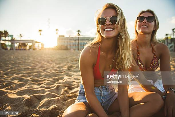 Girls relaxing on the beach