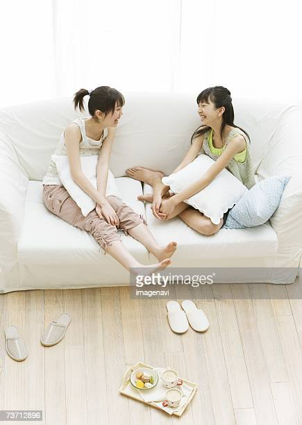 Girls relaxiong on the sofa