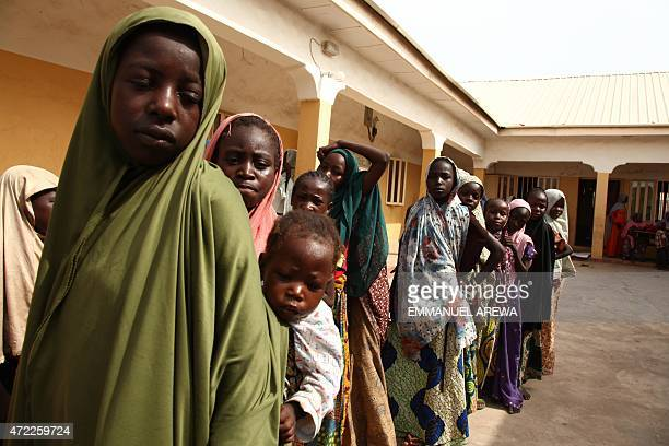 Girls rescued by Nigerian soldiers from Islamist militants Boko Haram at Sambisa Forest line up to collect donated clothes at the Malkohi refugee...
