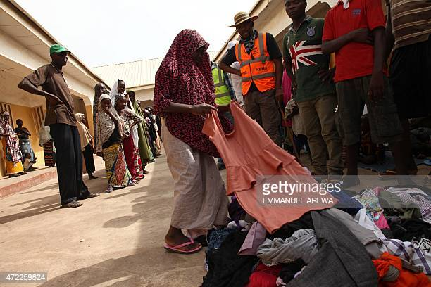 Girls rescued by Nigerian soldiers from Islamist militants Boko Haram at Sambisa Forest collect donated clothes at the Malkohi refugee camp in Yola...