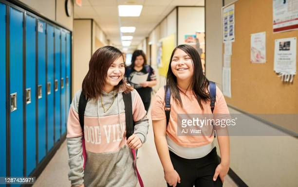 girls returning home after school - childhood stock pictures, royalty-free photos & images