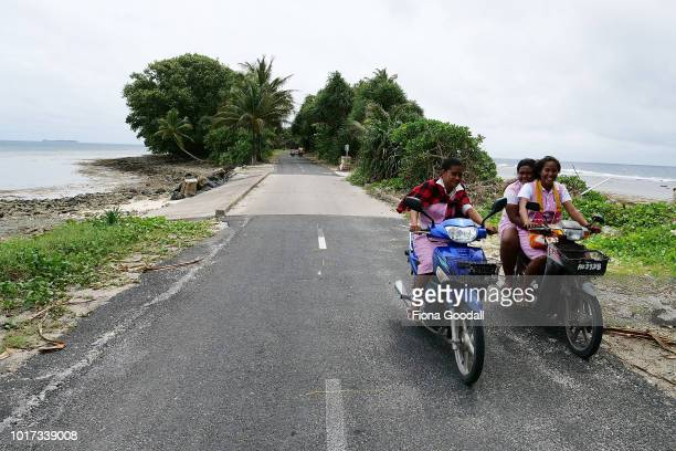 Girls ride home from school across the causeway on August 15 2018 in Funafuti Tuvalu The small South Pacific island nation of Tuvalu is striving to...