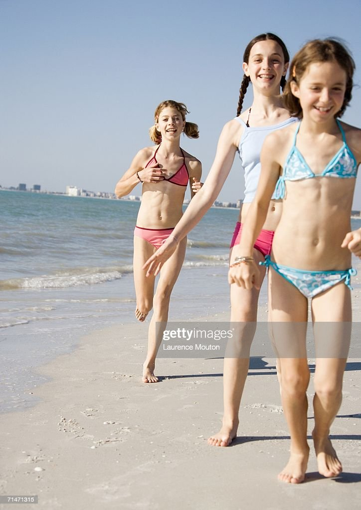 Girls Running And Walking On Beach Stock Photo