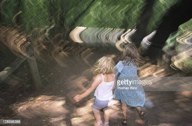 Girls running in the woods, Germany