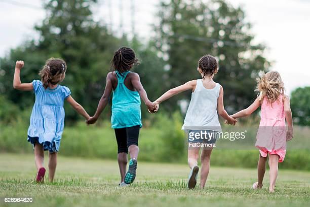 Girls Running Outside Together