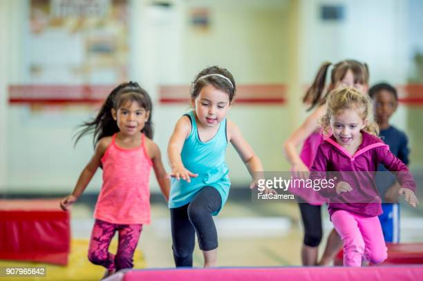 girls running - gymnastics stock pictures, royalty-free photos & images