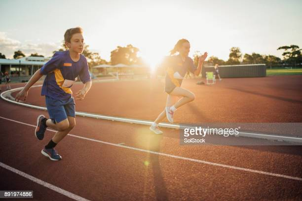 girls running race - athletics stock photos and pictures