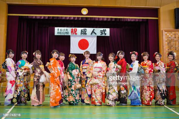 Girls seen wearing kimonos posing during the ceremony. 1.25 million People celebrated their passage into adulthood on the Coming of Age Day, a...
