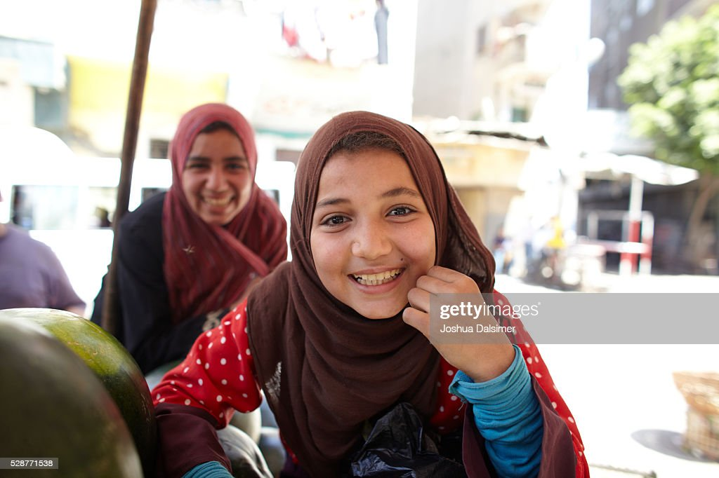 Girls selling melons on the streets of Cairo : Stock Photo