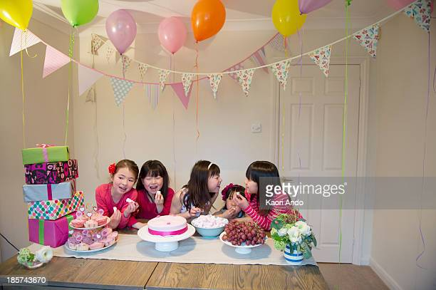 girls sharing birthday cake at party - cobham surrey stock pictures, royalty-free photos & images