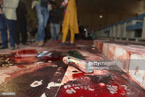 A girl's shoe lies on the floor in the bloodied ceremony hall at an armyrun school a day after an attack by Taliban militants in Peshawar on December...