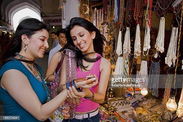 girls shopping - bangle stock pictures, royalty-free photos & images