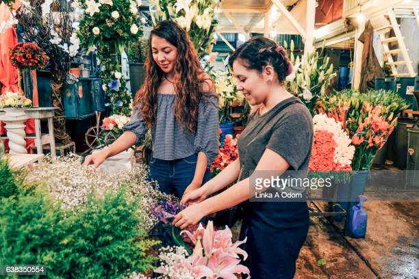 Girls shopping together in flower Market