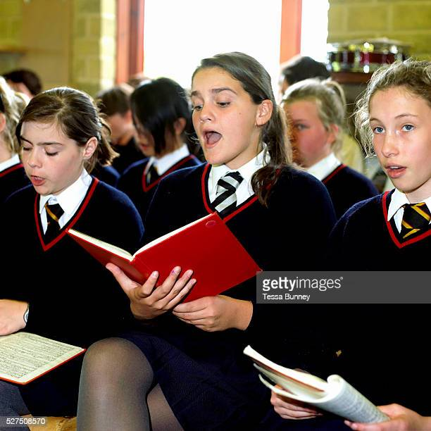 Girls singing at choir practice at Ampleforth College North Yorkshire UK Ampleforth College is a coeducational independent day and boarding school in...