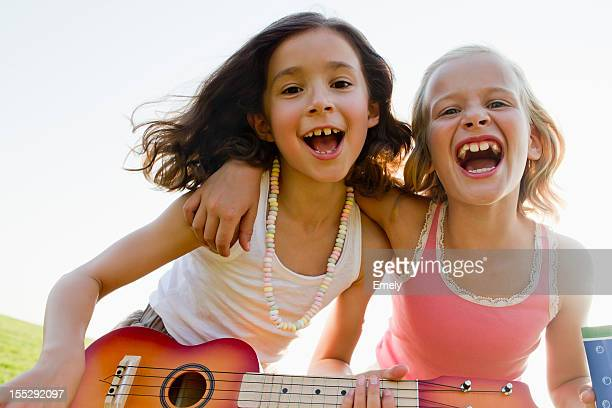 Girls singing together outdoors