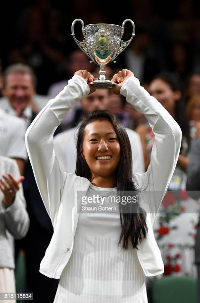 Girl's Singles final winner Claire Liu of the United States poses with her trophy on centre court on day twelve of the Wimbledon Lawn Tennis...