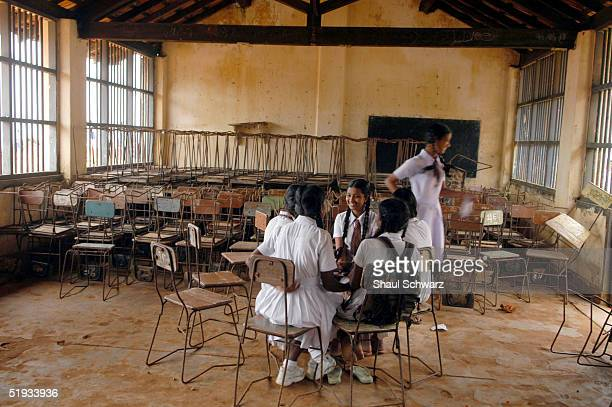 Girls sit in a circle and talk at Devapathiraja Rathgama School of Galle January 10 2005 in Galle Sri Lanka An estimated 150000 were killed in the...