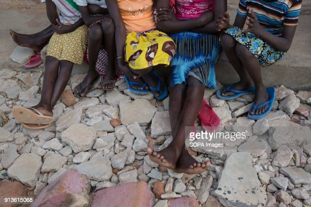 Girls sit in the yard at Kalas Girls Primary School Amudat District Karamoja Uganda They each escaped home after their families tried to force them...