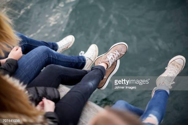 Girls sitting at water