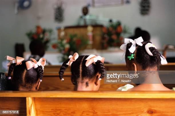 Girls Sitting in Church Pew on St. Lucia