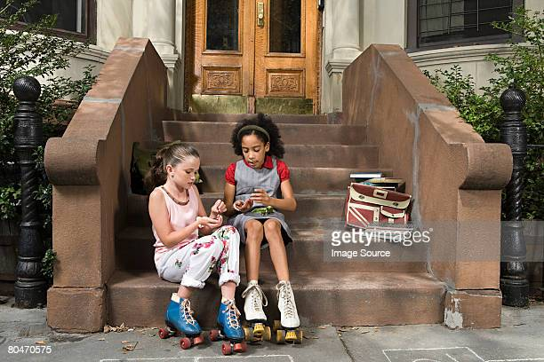 Girls sitting on steps