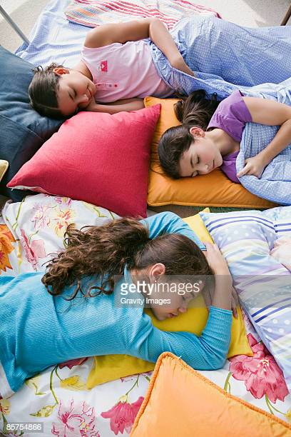 girls sleeping on floor at slumber party - slumber party stock pictures, royalty-free photos & images
