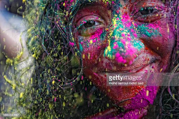 CONTENT] A girls smiles as her face is covered in colored powder during Holi festival celebrations in Kuala Lumpur March 31 2013 Holi Festival is...